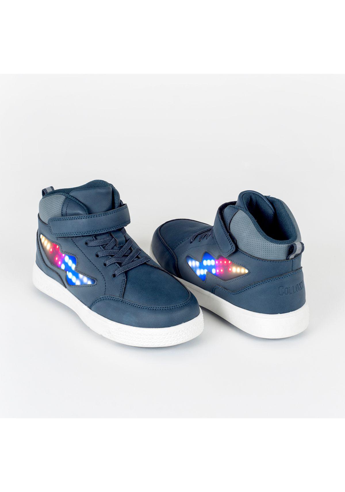 televisor Escudriñar Seguro  Zapatilla luces de niño LED velcro elastico azul (28 a 36) - Colloky Chile